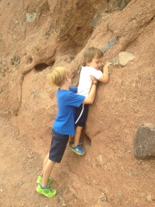 Help little brothers learn to boulder.
